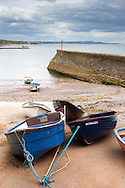 Dinghies brought to shore, near Coryton Cove, Dawlish, South Devon.