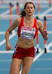 Jelena Jotanovic of Serbia competes during the first round of the women's 100m hurdles at the 2010 European Athletics Championships at the Olympic Stadium in Barcelona on July 30, 2010. (Photo by Vid Ponikvar / Sportida)