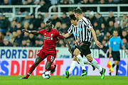 Sadio Mane (#10) of Liverpool takes on Ki Sung-Yueng (#4) of Newcastle United and Fabian Schar (#5) of Newcastle United during the Premier League match between Newcastle United and Liverpool at St. James's Park, Newcastle, England on 4 May 2019.