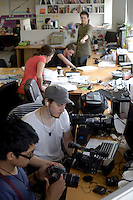Getup office in Sydney with National Director Simon Sheikh. Creative Director Simon Duncan Watt and intern Vonne Patiag organising their equipment.