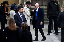 © Licensed to London News Pictures. 09/03/2020. LONDON, UK. Woody Johnson, US Ambassador, gives an elbow bump as he arrives at Westminster Abbey to attend the annual church service on Commonwealth Day.  Photo credit: Stephen Chung/LNP