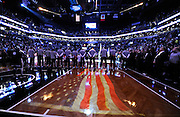 The Brooklyn Nets players line up for the singing of the National Anthem before the    NBA basketball game against the Sacramento Kings on Sunday, March 9, 2014 at Barclays Center in New York. (AP Photo/Kathy Kmonicek)