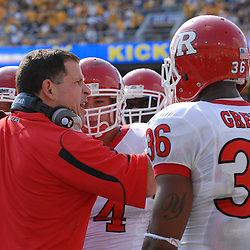 Oct 4, 2008; Morgantown, WV, USA; Rutgers head coach Greg Schiano instructs his defense after a long, unsuccessful goal line stand in the third quarter of Rutgers' 24-17 loss to West Virginia at Milan Puskar Stadium.