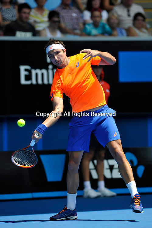 21.01.2015 Australian Open Tennis from Melbourne Park. Marinko Matosevic of Australia returns a shot in his match against Andy Murray of Great Britain on day three of the 2015 Australian Open at Melbourne Park, Melbourne, Australia.