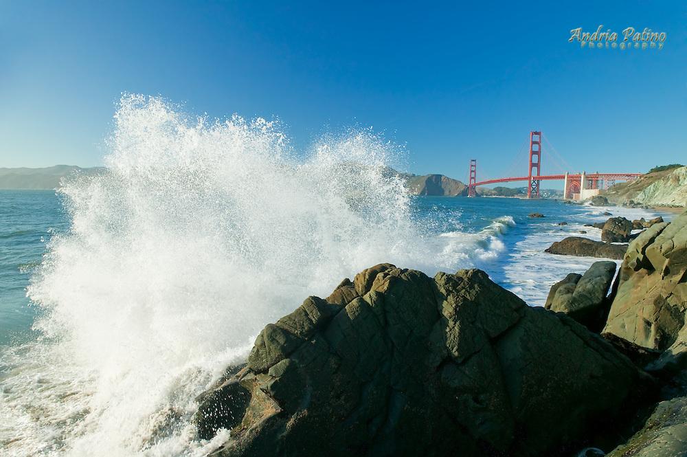 Splash against rock, Golden Gate Bridge from Baker Beach, San Francisco