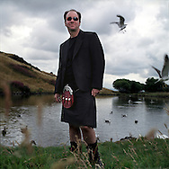 Ken Misch, a native of Las Vegas, USA, wearing a kilt from 21st Century Kilts, in Edinburgh's Holyrood Park, .Scotland, UK.