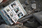 Photo shows a photo album found in the dirt of tsunami-wrecked Rikuzentakata, Iwate Prefecture, Japan on 06 April, 2011. .Photographer: Robert Gilhooly