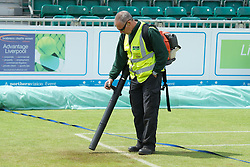 LIVERPOOL, ENGLAND - Saturday, June 23, 2012: Groundstaff use air blowers to prepare centre court for the Men's Final during day three of the Medicash Liverpool International Tennis Tournament at Calderstones Park. (Pic by David Rawcliffe/Propaganda)