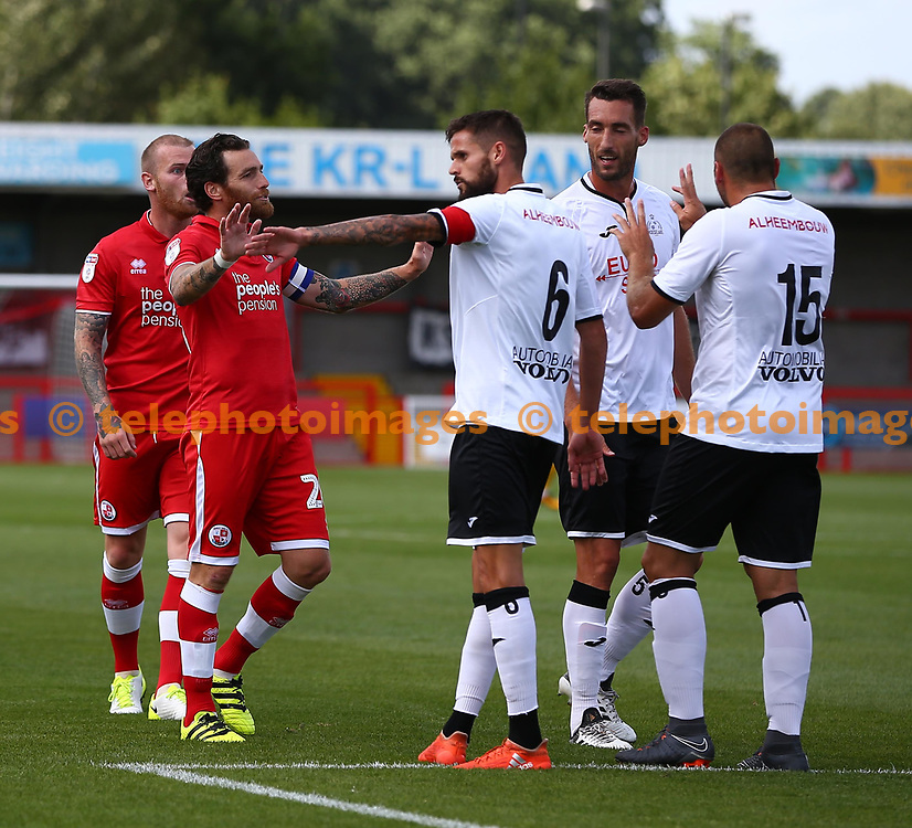 Crawley's Romain Vincelot calms things down as tensions run high during the pre season friendly between Crawley Town and KSV Roeselare at The Broadfield Stadium, Crawley , UK. 28 July 2018.