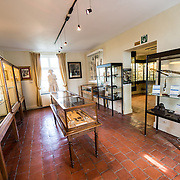 The Hussard's Room at the farmhouse known as Ferme du Caillou. Next to the field where the Battle of Waterloo took place in 1815, the farmhouse is famous as the place where Napoleon spent the night before the battle. It is now a museum. The room contains a number of side arms and other weapons used by French and Allied soldiers of the period. In the center of the room, in a glass display case, is a skeleton of a French hussar found nearby at the Ferme de la Haie-Sainte.