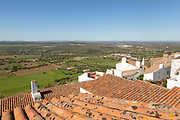 Historic walled hilltop village of Monsaraz, Alto Alentejo, Portugal, southern Europe view over rooftops north over countryside fields