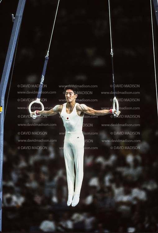 SEATTLE - JULY 1990:  Shinji Gamou of Japan performs on the still rings during the Men's Gymnastics competition of the 1990 Goodwill Games held from July 20 - August 5, 1990.  The gymnastics venue was the Tacoma Dome in Tacoma, Washington.  (Photo by David Madison/Getty Images)