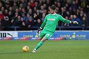 AFC Wimbledon goalkeeper Joe McDonnell (24) clearing the ball during the EFL Sky Bet League 1 match between AFC Wimbledon and Rochdale at the Cherry Red Records Stadium, Kingston, England on 8 December 2018.