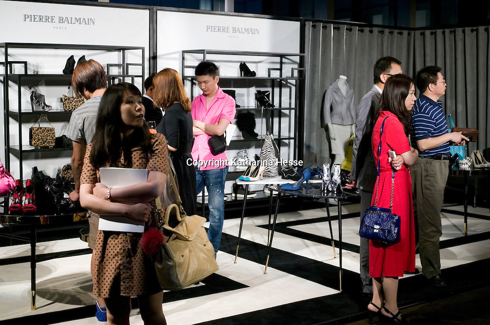 BEIJING, MAY-22 :  wealthy Chinese look at the accessories which are part of the Balmain spring/summer 2012 collection.