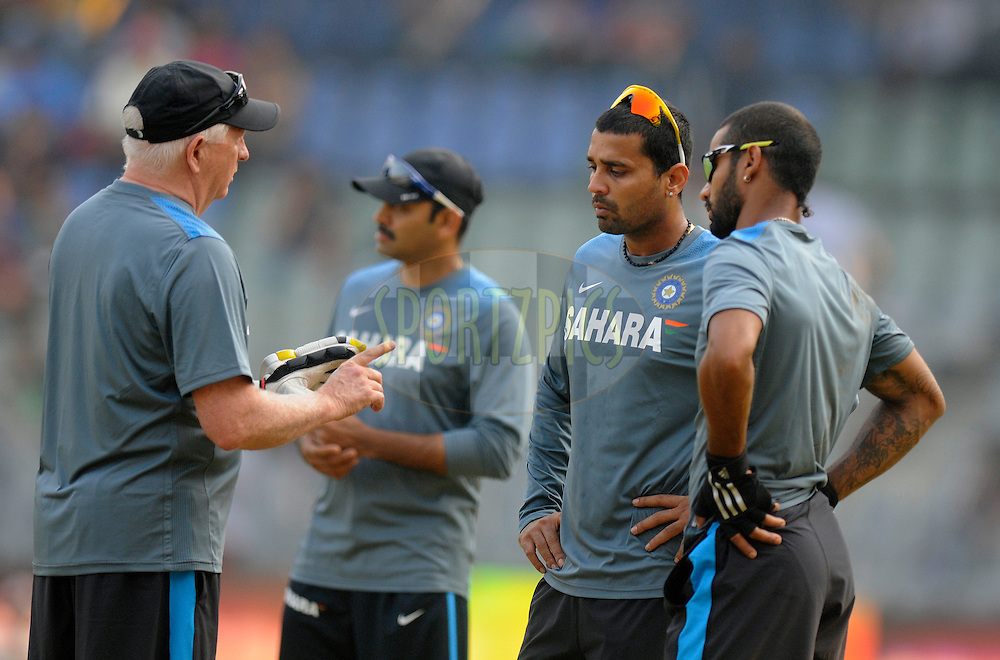 Duncan fletcher has a word with Shikhar Dhawan of India and Murali Vijay of India before the start of the play on day two of the second Star Sports test match between India and The West Indies held at The Wankhede Stadium in Mumbai, India on the 15th November 2013<br /> <br /> This test match is the 200th test match for Sachin Tendulkar and his last for India.  After a career spanning more than 24yrs Sachin is retiring from cricket and this test match is his last appearance on the field of play.<br /> <br /> <br /> Photo by: Pal PIllai - BCCI - SPORTZPICS<br /> <br /> Use of this image is subject to the terms and conditions as outlined by the BCCI. These terms can be found by following this link:<br /> <br /> http://sportzpics.photoshelter.com/gallery/BCCI-Image-Terms/G0000ahUVIIEBQ84/C0000whs75.ajndY