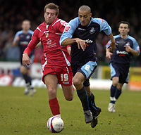 Photo: Matt Bright/Sportsbeat Images.<br /> Swindon Town v Swansea City. Coca Cola League 1. 01/01/2008.<br /> Darren Pratley of Swansea & Michael Pook of Swindon