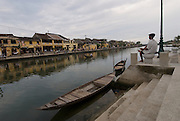 Vietnam: Hoi An. .Originally colonised by Chinese merchants, this traditional Vietnamese fishing community largely escaped damage during both the American and French Wars.Now protected by UNESCO, much of the original architecture remains in tact, providing a timeless reminder of the traditions of Vietnam...An elderly boatman ponders the view of Bach Dang across the Thu Bon River