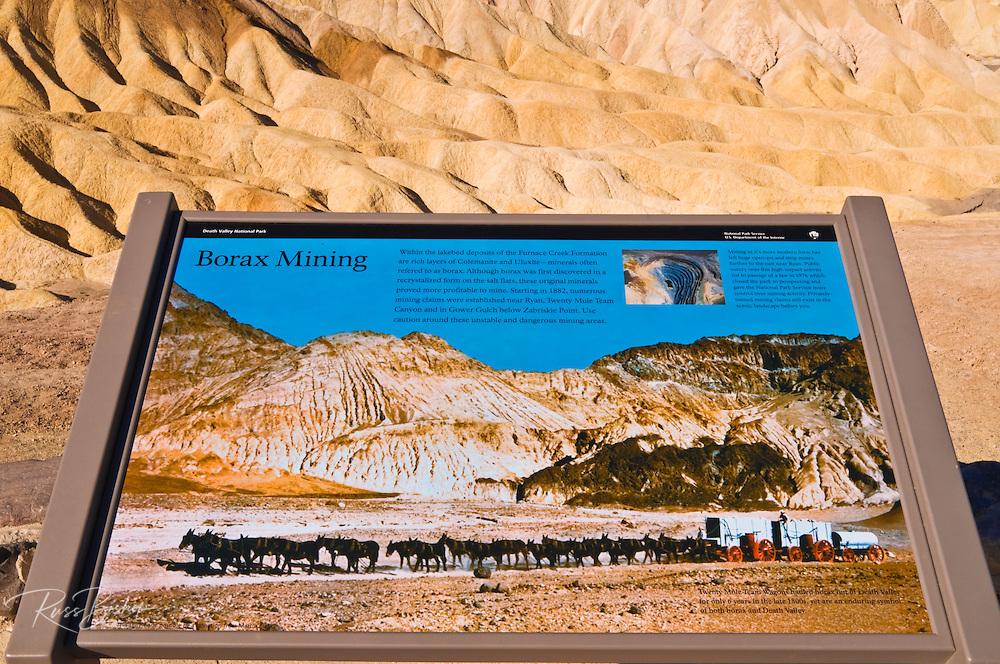 Interpretive sign and eroded hills at Zabriskie Point, Death Valley National Park. California