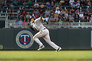 Carlos Gomez #27 of the Milwaukee Brewers sprints to 3rd base during a game against the Minnesota Twins on May 29, 2013 at Target Field in Minneapolis, Minnesota.  The Twins defeated the Brewers 4 to 1.  Photo: Ben Krause