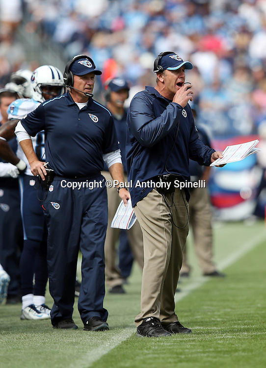 Tennessee Titans tight ends coach Mike Mularkey calls out from the sideline during the NFL week 6 regular season football game against the Jacksonville Jaguars on Sunday, Oct. 12, 2014 in Nashville, Tenn. The Titans won the game 16-14. ©Paul Anthony Spinelli