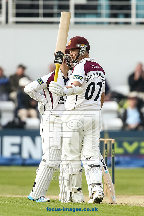 James Middlebrook of Northamptonshire County Cricket Club acknowledges the applause on reaching his half-century during the LV County Championship Div One match at the County Ground, Northampton. <br /> Picture by Andy Kearns/Focus Images Ltd 0781 864 4264  29/04/2014