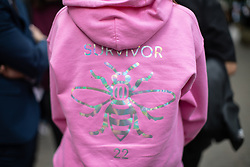 "© Licensed to London News Pictures . 22/05/2019. Manchester, UK . A woman wearing a hoodie with the word "" Survivor "" and the number 22 on the reverse . People in St Ann's Square in Manchester City Centre on the second anniversary of the Manchester Arena bombing following a private service in St Ann's Church . On the evening of 22nd May 2017 , Salman Abedi murdered 22 people and seriously injured dozens more , when he exploded a bomb in the foyer of the Manchester Arena as concert-goers were leaving an Ariana Grande gig . Photo credit: Joel Goodman/LNP"