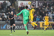 Swansea City goalkeeper Lukasz Fabianski and Tomer Hemed of Brighton & Hove Albion during the Premier League match between Swansea City and Brighton and Hove Albion at the Liberty Stadium, Swansea, Wales on 4 November 2017. Photo by Andrew Lewis.
