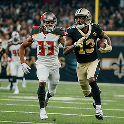Sep 9, 2018; New Orleans, LA, USA; New Orleans Saints wide receiver Michael Thomas (13) runs past Tampa Bay Buccaneers cornerback Carlton Davis (33) during the first half of a game at the Mercedes-Benz Superdome. Mandatory Credit: Derick E. Hingle-USA TODAY Sports