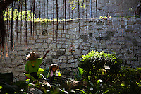 Workmen in the grounds of the old fort near the St Pauls facade in historic Macau.