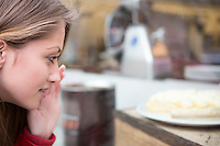 Close-up of woman looking at cake in cafe