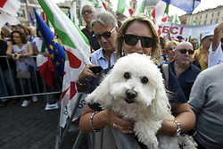Italy, Rome - September 30, 2018.Demonstran of the center-left Democratic Party (PD) against populist coalition Salvini - Di Maio government at Piazza del Popolo.Tens of thousands of Italians rallied in Rome Sunday for the center-left Democratic Party (PD) as it seeks to rebound from a shock defeat to a populist coalition in June. (Credit Image: © Mistrulli/Fotogramma/Ropi via ZUMA Press)