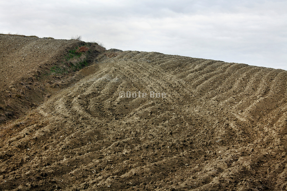 bare agricultural crop land with track signs