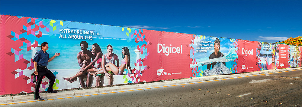 Commercial banner for Digicel, Cayman on display at the airport