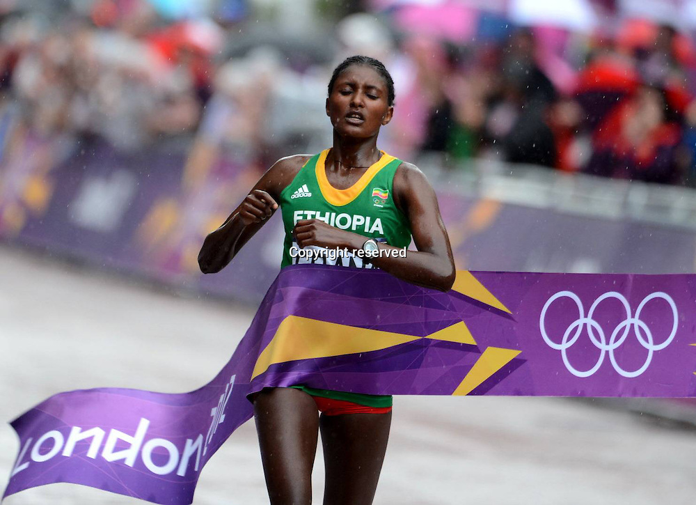 05.08.2012. London, England. Olympic Games London 2012  Marathon for Women. Tiki Gelana of Ethiopia crosses the finish line and wins the gold medal