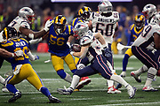 New England Patriots running back Rex Burkhead (34) runs for a fourth quarter gain of 26 yards and a first down at the Los Angeles Rams 33 yard line during the NFL Super Bowl 53 football game on Sunday, Feb. 3, 2019, in Atlanta. The Patriots defeated the Rams 13-3. (©Paul Anthony Spinelli)