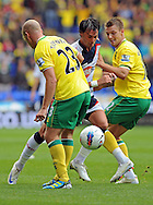 Picture by Chris Donnelly/Focus Images Ltd. 07500 903009 .17/9/11.Chris Eagles of Bolton Gets past Marc Tierney and Anthony Pilkington of Norwich during the Barclays Premier League match at Reebok stadium, Bolton.