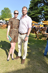 JADE PARFITT and JACK DYSON at the Summer Solstice Party during the Boodles Tennis event hosted by Beulah London and Taylor Morris at Stoke Park, Park Road, Stoke Poges, Buckinghamshire on 21st June 2014.