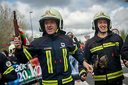 "Firefighters carry the baton while running on the 20th Korrika.  Irun (Basque Country). April 4, 2017. The ""Korrika"" is a relay course, with a wooden baton that passes from hand to hand without interruption, organised every two years in a bid to promote the basque language. The Korrika runs over 11 days and 10 nights, crossing many Basque villages and cities. This year was the 20th edition and run more than 2500 Kilometres. Some people consider it an honour to carry the baton with the symbol of the Basques, ""buying"" kilometres to support Basque language teaching. (Gari Garaialde / Bostok Photo)"