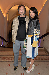 MARC NEWSON and CHARLOTTE STOCKDALE at a private view of photographs by David Bailey entitled 'Bailey's Stardust' at the National Portrait Gallery, St.Martin's Place, London on 3rd February 2014.
