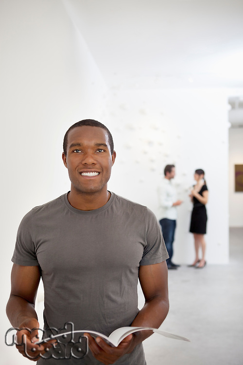Front view of young man in casual looking up