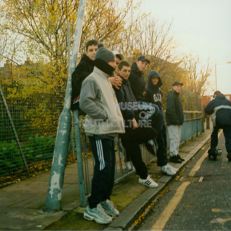 A group of bored lads standing around on the street