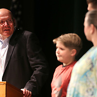 With his family on stage, Dr. Gearl Loden, Superintendent of the Tupelo School District, looks back on his time as Superintendent in Tupelo during the district's end of the year convocation Thursday morning at the Performing Arts Center at Tupelo High School.