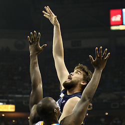 April 1, 2011; New Orleans, LA, USA; Memphis Grizzlies center Marc Gasol (33) shoots over New Orleans Hornets center Emeka Okafor (50) during the first quarter at the New Orleans Arena.    Mandatory Credit: Derick E. Hingle