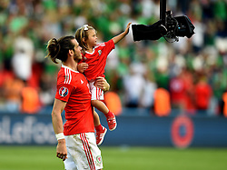Gareth Bale of Wales celebrates with his daughter Alba Violet Bale  - Mandatory by-line: Joe Meredith/JMP - 25/06/2016 - FOOTBALL - Parc des Princes - Paris, France - Wales v Northern Ireland - UEFA European Championship Round of 16
