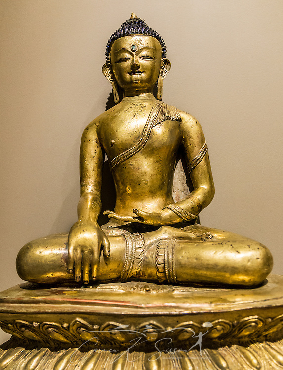 A Tibetan, gilded bronze statue of Shakyamuni Buddha, circa  the 13th-14th century is displayed at the Michael C. Carlos Museum at Emory University, July 8, 2014, in Atlanta, Georgia. The museum was founded in 1876 and contains more than 17,000 artifacts in its permanent collections. (Photo by Carmen K. Sisson/Cloudybright)