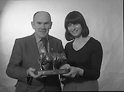 1980-02-19.19th February 1980.19-02-1980.02-19-80..The Bronze Cow:..Photographed at: location unspecified..Frank Flanagan, Chairman of National Dairy Council and Irene Cunningham, Ranks (I) Ltd,  admiring the Bronze Cow Trophy  due to be awarded at the Munster Dairy Farmer of the Year event. The trophy is the work of Rowan Gillespie who is also responsible for the GAA All Star trophies.