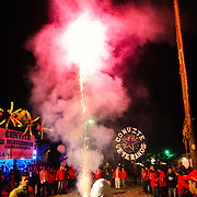 Revelers watch a box of fireworks go off in the main street in front of the Church of Santo Tomas as part of Convite 12 de Dicembre in Chichicastenango in celebration of the Day of Our Lady of Guadalupe.. Chichicastenango is an indigenous Maya town in the Guatemalan highlands about 90 miles northwest of Guatemala City and at an elevation of nearly 6,500 feet. It is most famous for its markets on Sundays and Thursdays.