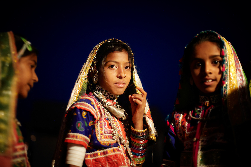 A harijan girl, who is attending a local wedding, wearing the traditional costume and jewelry of Kutch.<br /> Kutch (Kachchh), Gujarat, India