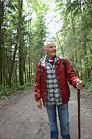Senior man walking in forest