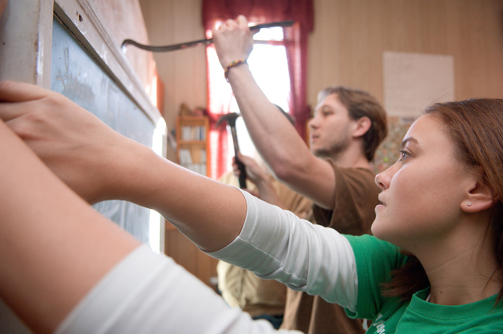 18537Students volunteering at a local church in Mineral, Ohio during MLK Day on January 21, 2008..Josh Clayton and Rebecca L. Hug take down chalk board.
